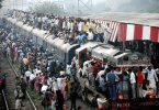 Hindu devotees travel in an overcrowded train as they return after taking holy dips in the Ganges river near Chandause, Uttar Pradesh state, India, Monday, Oct. 29, 2012. (AP Photo) INDIA OUT